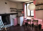 Kitchen with fireplace in Lemna