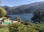 view of the lake como from the garden of the villa for sale