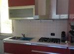 kitchen in carate urio to rent